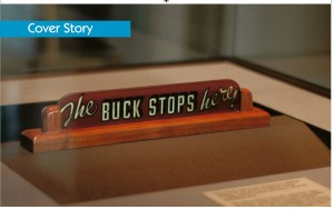 An image of Harry Truman's desk sign saying 'The Buck Stops Here'